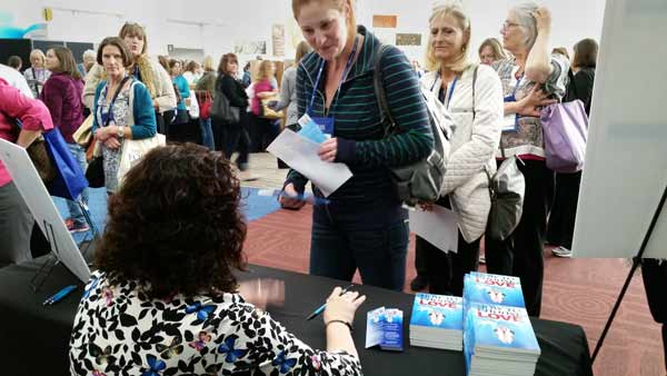 Diane Haworth talking with book signing attendee